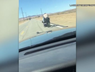 Deputy pushes woman a mile to home after motorized wheelchair stalls on road