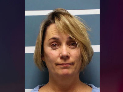 Teacher charged after video showed her forcing haircut on student