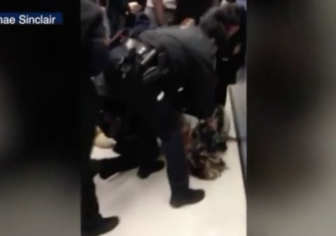'Unacceptable' video shows cops pulling baby from woman