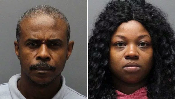 2 arrested for allegedly dumping man's body found in duffel bag outside bank