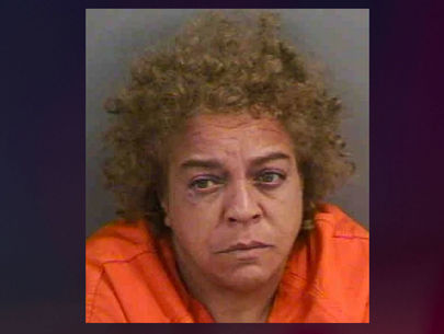 Woman accused of robbing mail carrier with plastic gun, riding away on tricycle