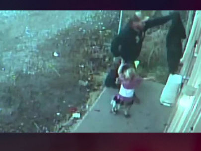 Man caught on video burglarizing flower shop with toddler in tow