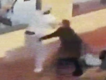 VIDEO: Valet thwarts robbery after man yanks woman, drags her