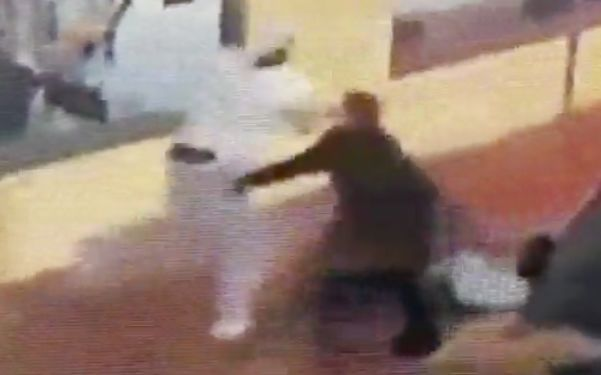 Video shows valet thwart robbery after man yanks woman, drags her along downtown sidewalk: LAPD