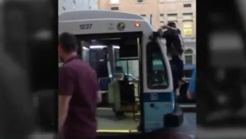 Video shows man on front of MTA bus getting yanked down, tackled in apparent citizen's arrest