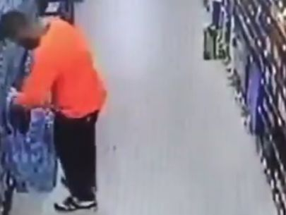 Police seek man caught on video tampering with water in grocery store