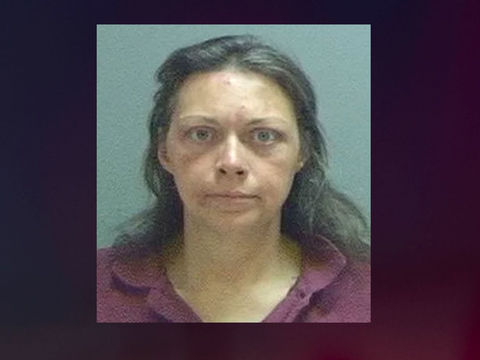 Police: Woman beat parents with mother's cane, oxygen tanks