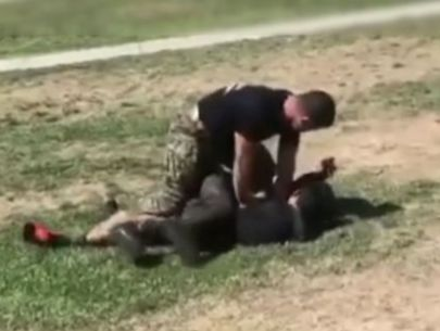 Marine seen plowing into brawling high school students