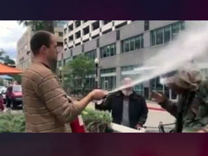 Restaurateur shoots fire extinguisher in face of man smoking