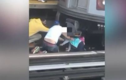 Man jumps on train tracks with daughter; man dies, daughter lives