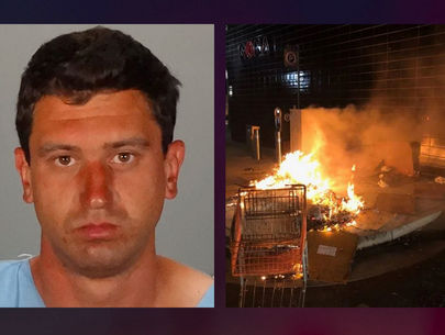 Man arrested for allegedly setting homeless man on fire, taking pics