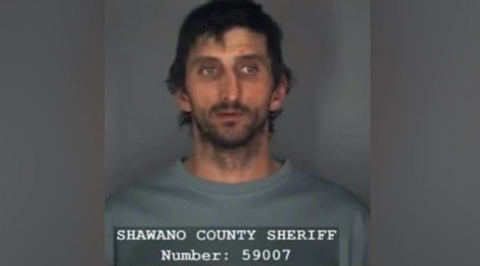 Man arrested after 8-year-old escapes home wearing straitjacket, locks