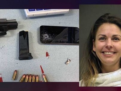 Woman arrested after shooting phone, bullet went through neighbor's wall