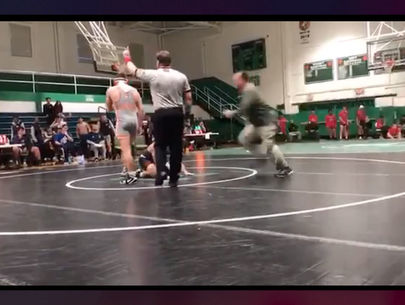Dad arrested after tackling high school athlete at wrestling tournament