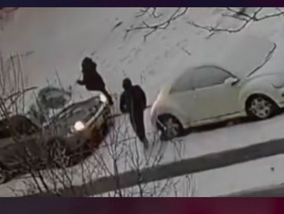 Video: Men pursue suspect who robbed woman cleaning snow off her car