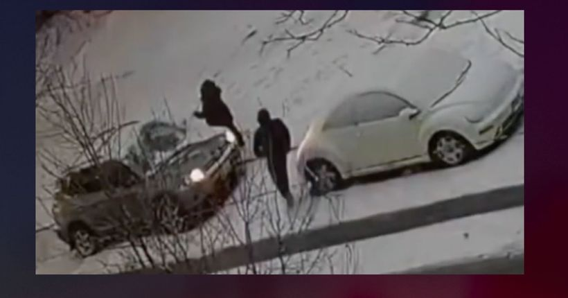 Two men try to take down man who robbed woman while she was cleaning snow off her car