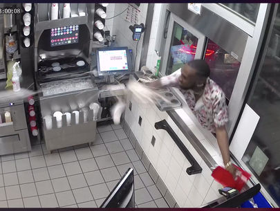 VIDEO: Deputies seek man who climbed into drive-thru window