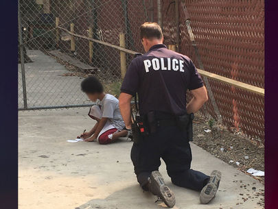 Officer uses paper and pencil to help autistic child find family