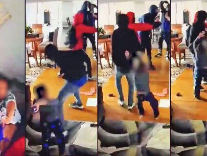 Home security video shows small boy fighting with armed robbers