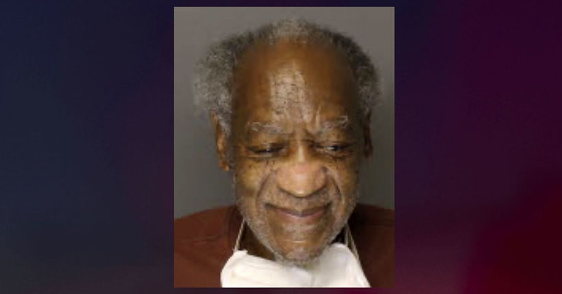 Bill Cosby smiles in new mug shot